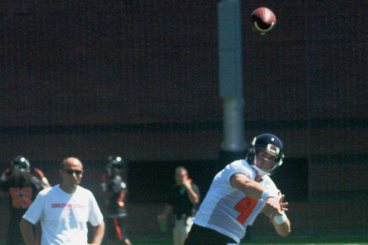 Oregon St. head coach Mike Riley takes a good look at Sean Mannion's form.