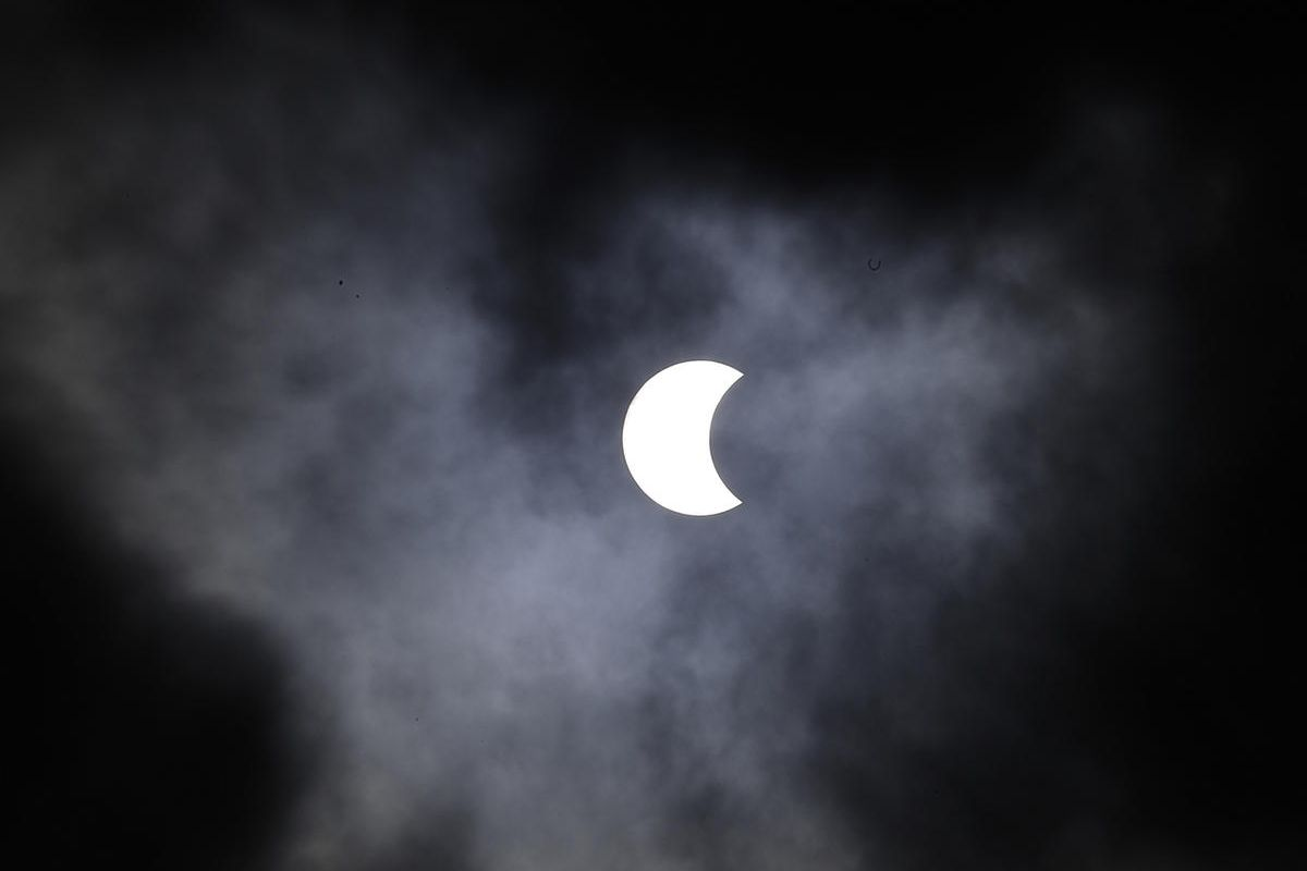 The moon passes in front of the sun, creating a solar eclipse visible in the southern hemisphere, seen from from Sao Paulo, Brazil, Sunday, Feb. 26, 2017. (AP Photo/Andre Penner)