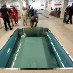 People check out the under water treadmill in the new Spence and Cleone Eccles Football Center at the University of Utah in Salt Lake City on Thursday, Aug. 15, 2013.