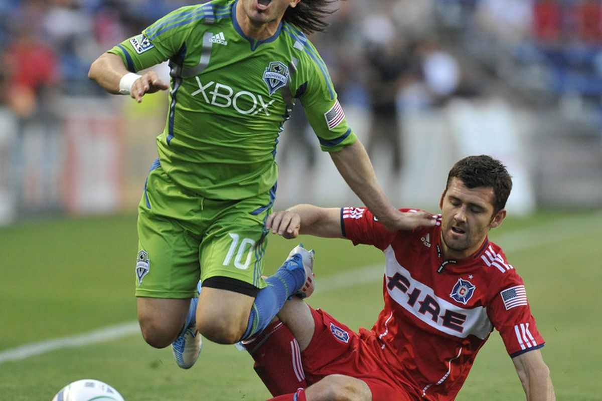BRIDGEVIEW, IL - JUNE 4: Mauro Rosales #10 of the Seattle Sounders FC and Gonzalo Segares #13 of the Chicago Fire battle for the ball in an MLS match on June 4, 2011 at Toyota Park in Bridgeview, Illinois.  (Photo by David Banks/Getty Images)