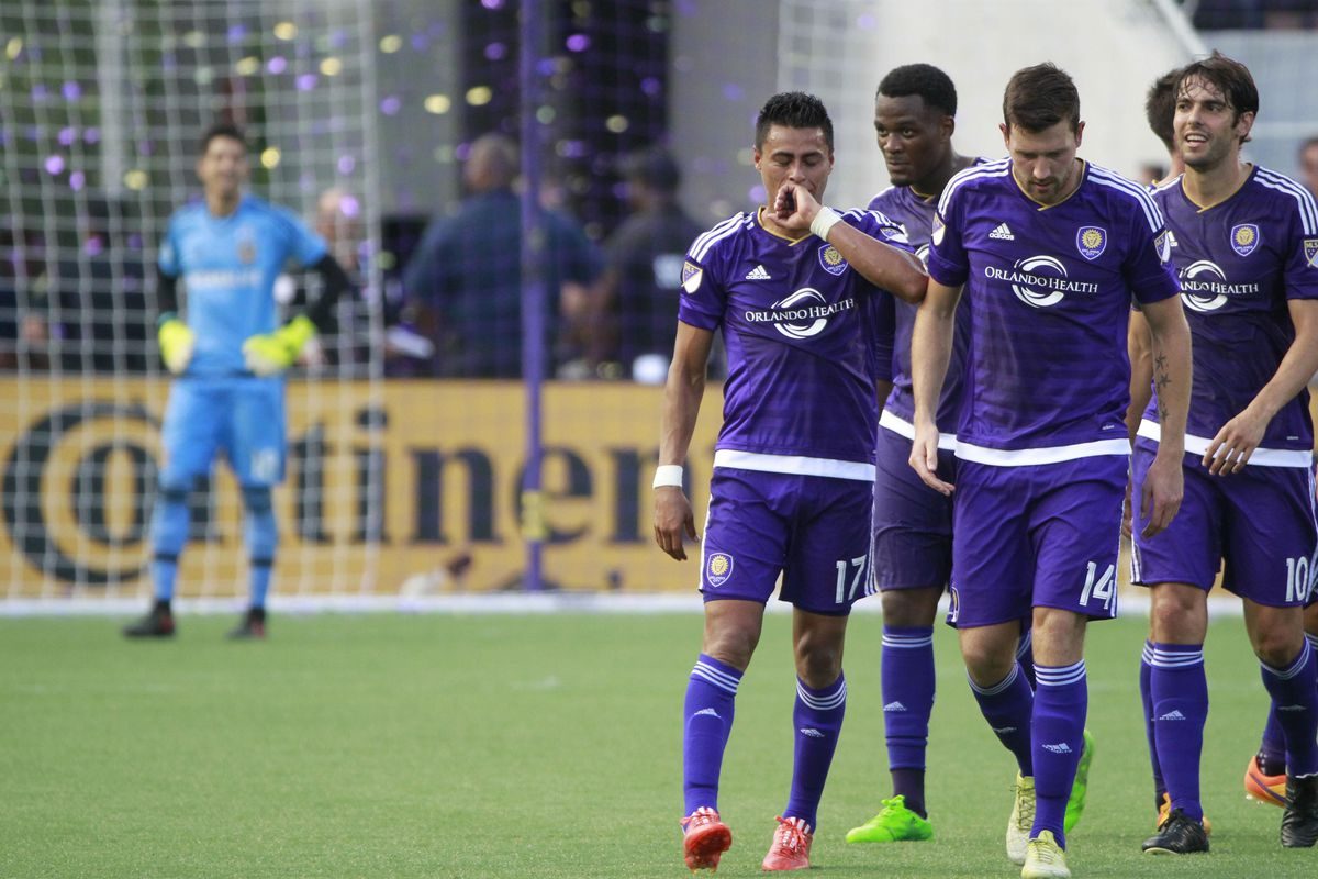 OCSC players celebrate after Darwin Ceren scores the fourth goal in their 4-0 thrashing of the LA Galaxy.