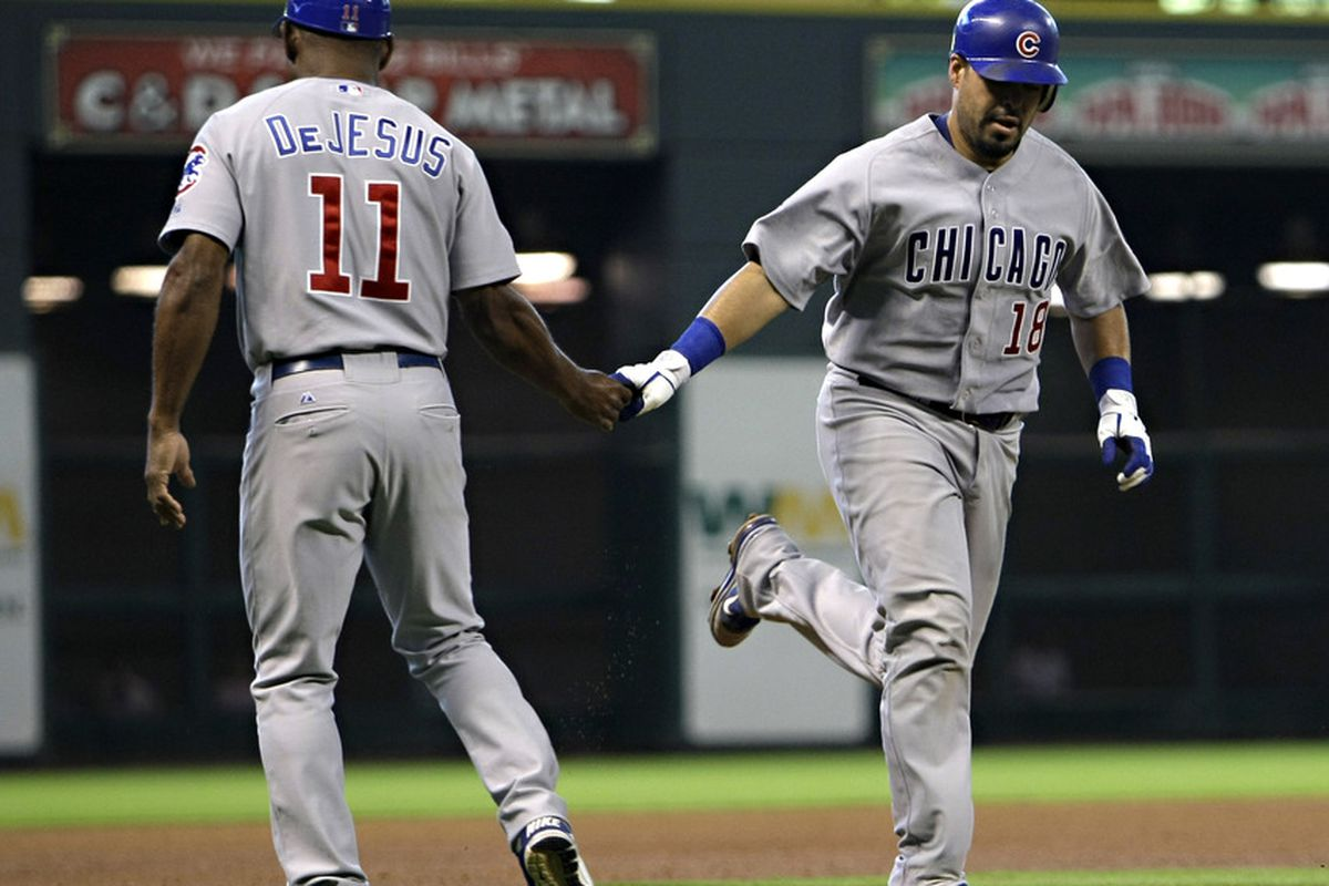 Geovany Soto of the Chicago Cubs receives congratulations after hitting a home run in the fourth inning against the Houston Astros at Minute Maid Park in Houston, Texas.  (Photo by Bob Levey/Getty Images)