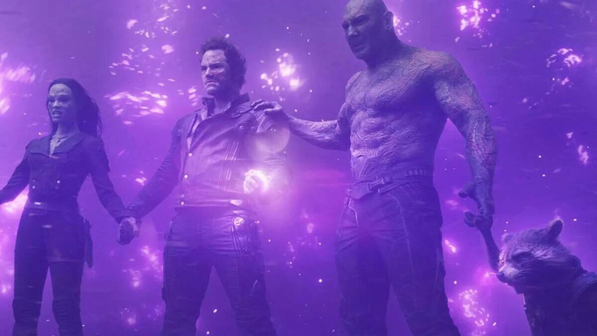 Gamora, Peter Quill, Drax, and Rocket hold the Power Stone