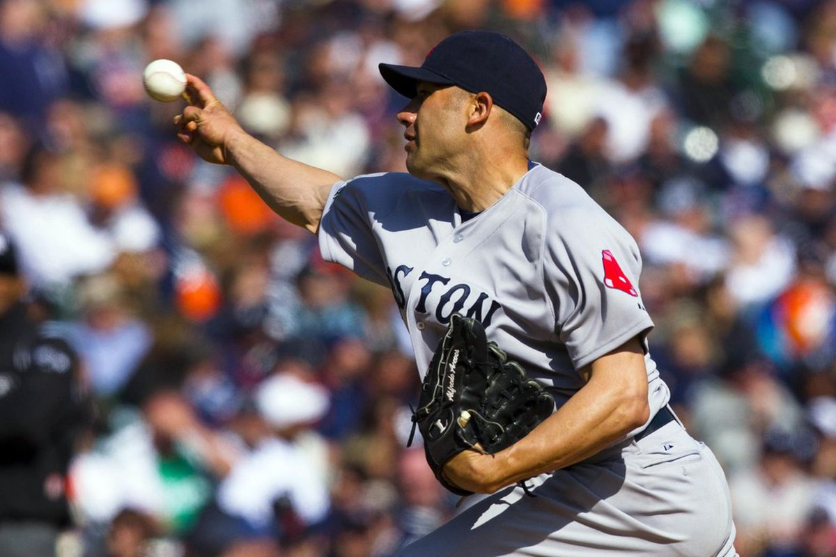 Boston Red Sox relief pitcher Alfredo Aceves pitches during the ninth inning against the Detroit Tigers at Comerica Park. Detroit won 3-2. Mandatory Credit: Rick Osentoski-US PRESSWIRE