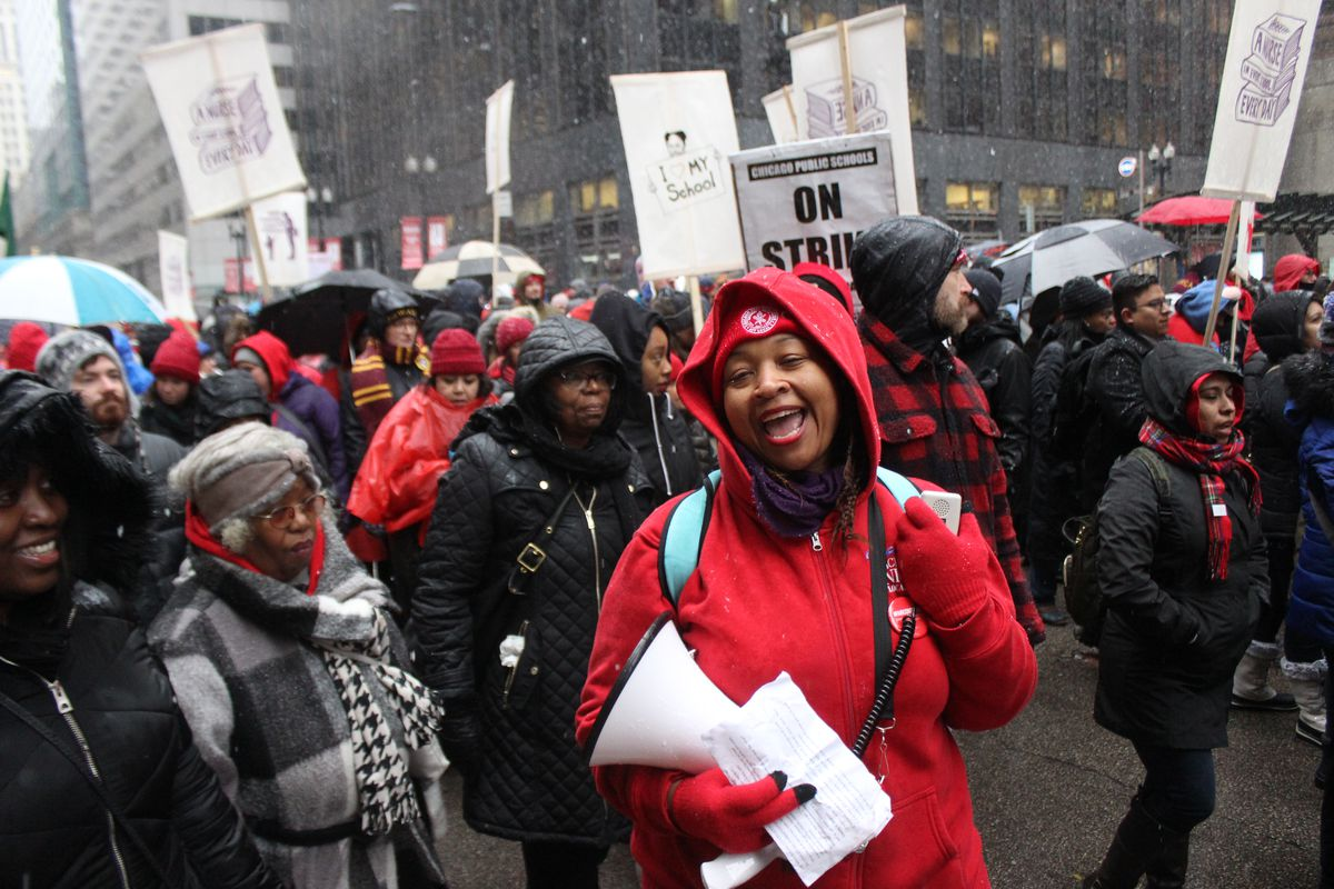 Chicago Teachers Union members rallied outside City Hall on the 11th day of their strike, the morning after the union endorsed a conditional agreement.
