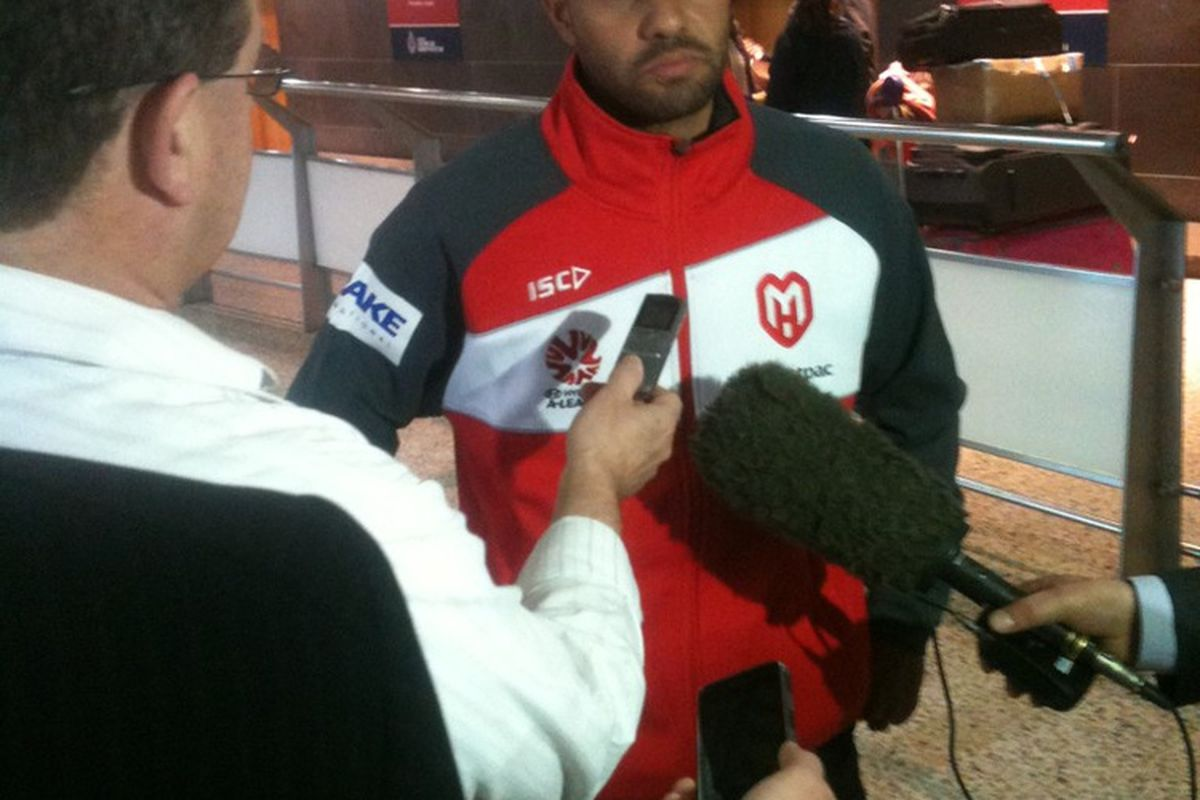 Fred addresses Australian media after arriving in the country. (Photo courtesy of dingyv03 of the Australian 442 Forums)