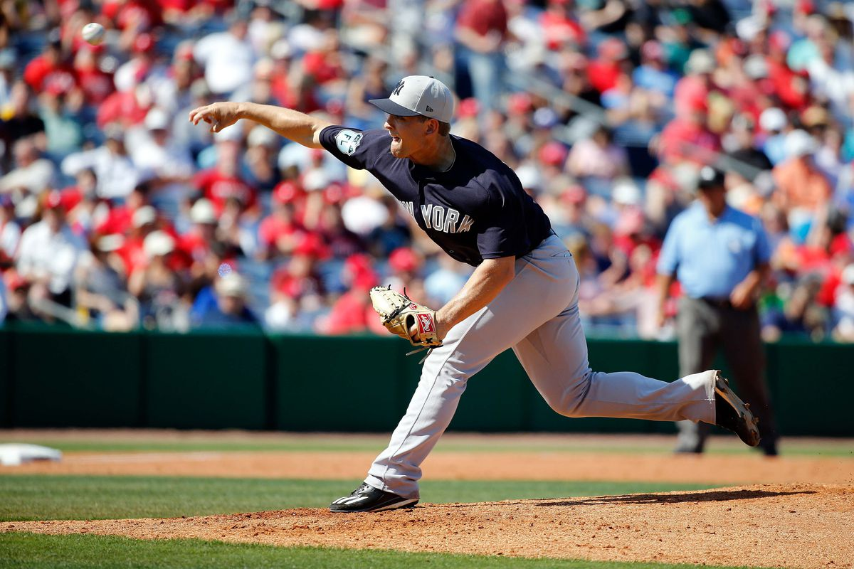 Chance Adams pitches against the Philadelphia Phillies during spring training.