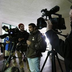 Photographers watch for Tuah, an orangutan at Salt Lake City's Hogle Zoo on Thursday, Feb. 4, 2016. Tuah picked the Carolina Panthers to beat the Denver Broncos in Super Bowl 50, which will be played Sunday at Levi's Stadium in Santa Clara, California. For the past eight years, an animal at Hogle Zoo has correctly predicted the winner of the Super Bowl.