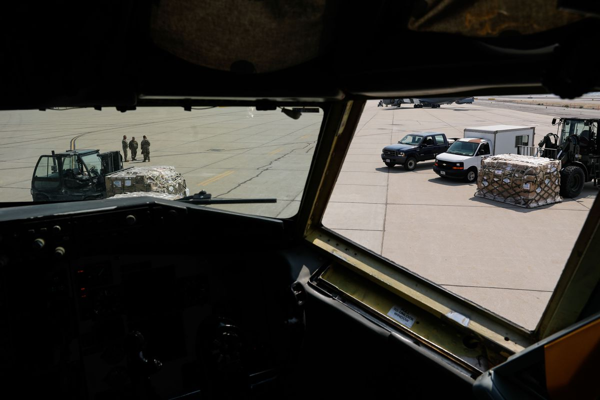Equipment and supplies to assist Nepal's COVID-19 response is seen from the cockpit of a KC-135 before it it is loaded at Roland R. Wright Air National Guard Base in Salt Lake City on Thursday, Aug. 26, 2021.