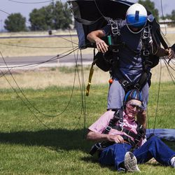 Wendell Ashcroft, left, disentangles himself from tandem instructor Scotty Freeland and their parachute at Skydive Ogden in Ogden on Saturday, Aug. 5, 2017.
