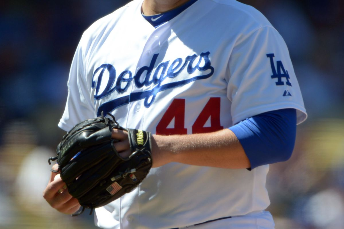 Aug 26, 2012; Los Angeles, CA, USA: Los Angeles Dodgers starting pitcher Aaron Harang (44) reacts against the Miami Marlins at Dodger Stadium. Mandatory Credit: Kirby Lee/Image of Sport-US PRESSWIRE