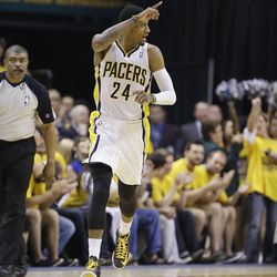 Indiana Pacers small forward Paul George (24) reacts to play against the Miami Heat during the first half of Game 6 of the NBA Eastern Conference basketball finals in Indianapolis, Saturday, June 1, 2013.