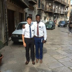 LDS Church full-time missionary Elder Bolaji Adepoju, right, with companion Elder Taylor Hansen on the streets of Palermo, Sicily.