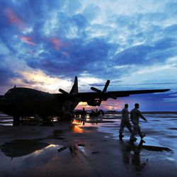 Food and supplies are unloaded from a military transport plane in Tacloban, Wednesday, Nov. 20, 2013, following a typhoon in the Philippines. Passengers were later loaded and allowed to ride to Cebu.