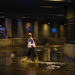 City workers remove water from Lower Wacker Drive near Randolph Street after overnight flooding, Monday morning, May 18, 2020.