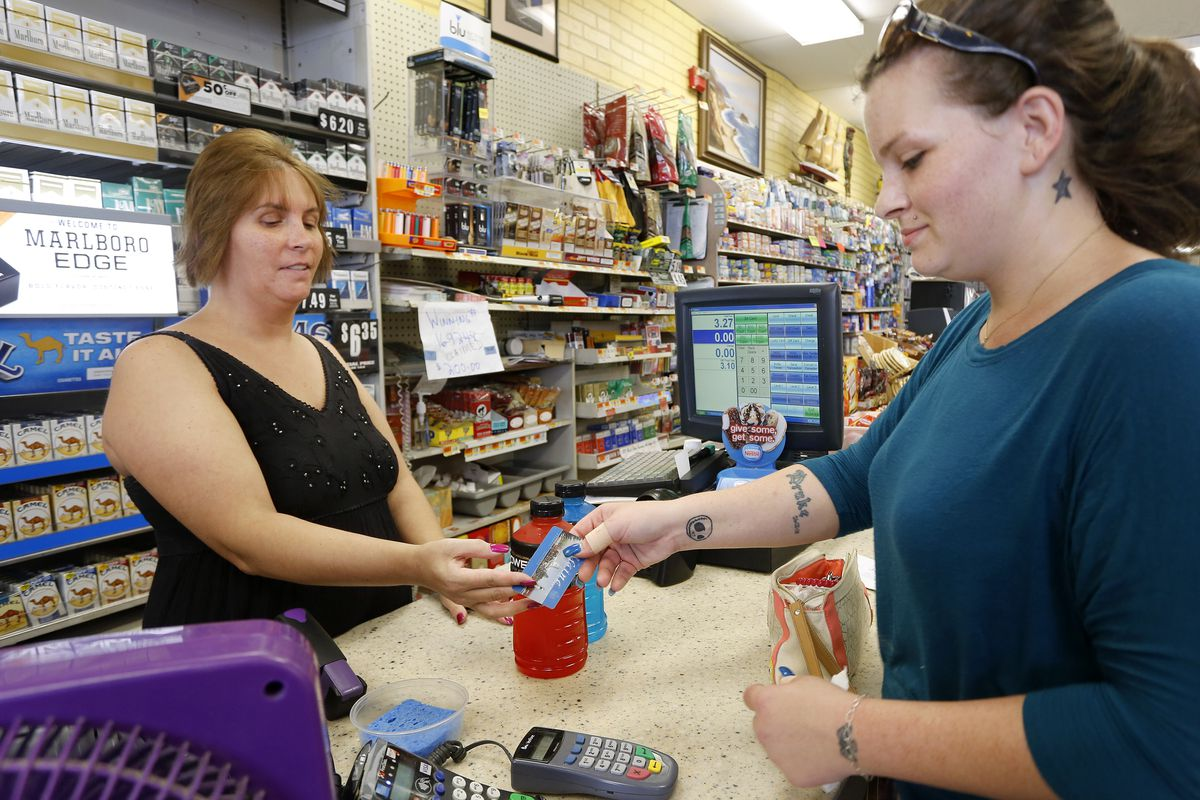 Stormie Whitten, 25, uses her Maine EBT card while shopping for groceries at Paul's grocery store. Gov. Paul LePage announced Wednesday that Maine will no longer seek a federal waiver that allows some able-bodied adults to receive food stamps without work