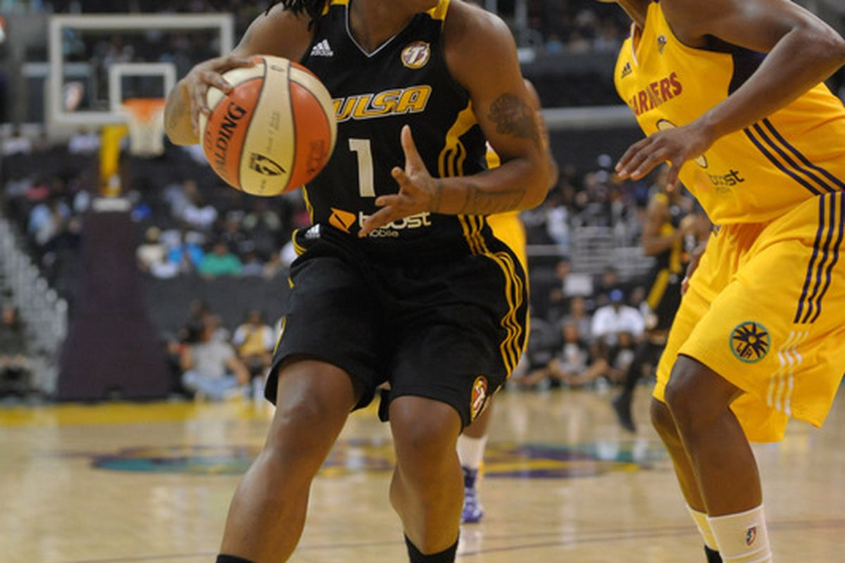 May 29, 2012; Los Angeles, CA, USA; Tulsa Shock guard Riquna Williams (1) is defended by Los Angeles Sparks guard Alana Beard (0) at the Staples Center. The Sparks defeated the Shock 76-75. <em>Photo by Kirby Lee/Image of Sport-US PRESSWIRE</em>
