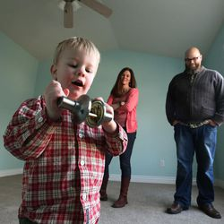 Blair Christensen and Kristan Warnick watch as their son Seth plays with a door handle in Salt Lake City Thursday, Jan. 21, 2016.