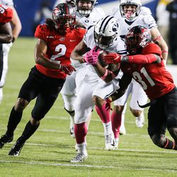 Brigham Young Cougars running back Tyler Allgeier (25) carries the ball against the Western Kentucky Hilltoppers defense for a first down during an NCAA football game at LaVell Edwards Stadium in Provo on Saturday, Oct. 31, 2020.