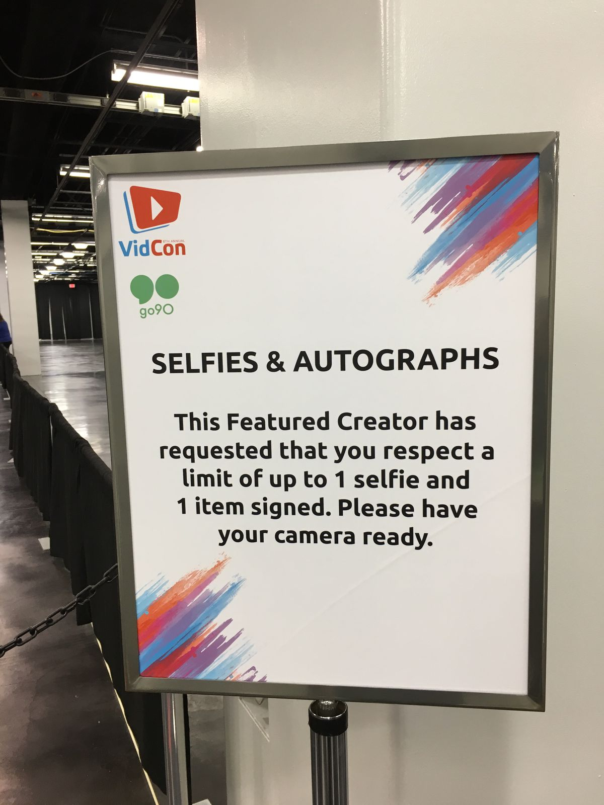 """Sign for selfies and autographs that reads, """"This Featured Creator has requested that you respect a limit of up to 1 selfie and 1 item signed. Please have your camera ready."""""""