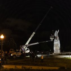 City crews begin to remove the Christopher Columbus Statue in Grant Park, Friday, July 24, 2020.