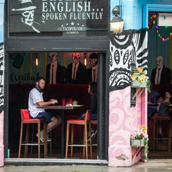 Customers eat at Broken English Taco Pub, 1400 N. Wells St., in Old Town on the first day of Illinois' Phase 4 reopening, Friday afternoon, June 26, 2020.