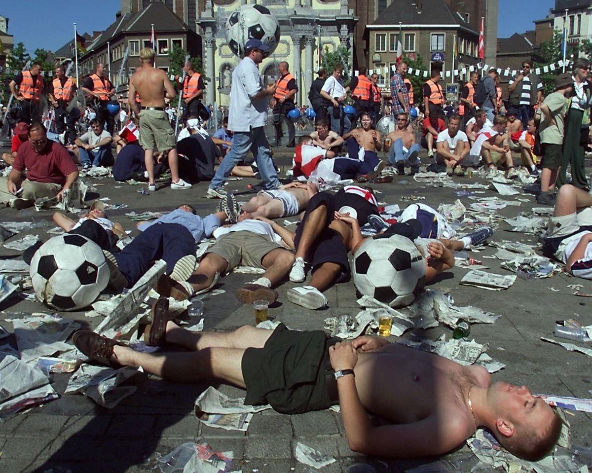 Drunken football fans rest on Charleroi Charles II