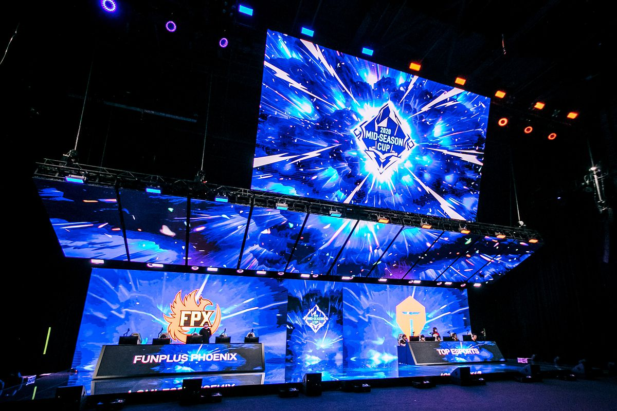 League of Legends Pro League teams FunPlus Phoenix (L) and Top Esports (R) compete during the League of Legends Mid-Season Cup finals at the LPL Arena on May 31.