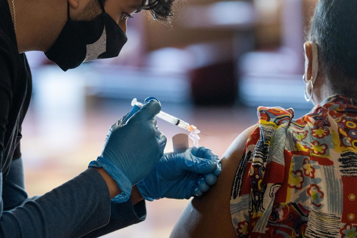 A person receives the Moderna COVID-19 vaccine in a vaccination site at Chicago Vocational Career Academy in March.