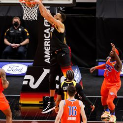 Utah Jazz center Rudy Gobert (27) dunks during the game against the Oklahoma City Thunder at Vivint Smart Home Arena in Salt Lake City on Tuesday, April 13, 2021.