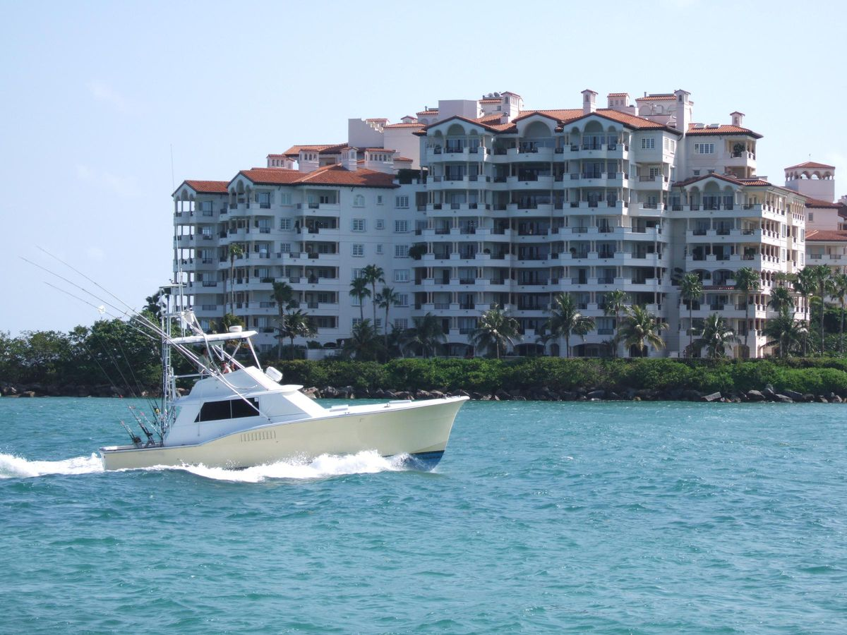 A boat passing Fisher Island in Miami Beach