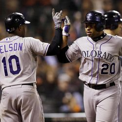 Colorado Rockies' Wilin Rosario (20) celebrates his two-run home run with teammate Chris Nelson (10) during the eighth  inning of a baseball game against the San Francisco Giants on Tuesday, Sept. 18, 2012 in San Francisco.