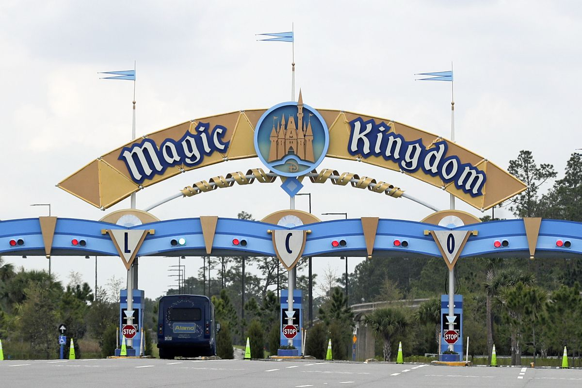 In this March 16, 2020, file photo, the entrance to the parking lot at the Magic Kingdom at Walt Disney World is closed in Lake Buena Vista, Fla. Squeezed by limits on attendance at its theme parks and other restrictions due to the pandemic, The Walt Disney Co. said Tuesday, Sept. 29, 2020, it planned to lay off 28,000 workers in its parks division in California and Florida.