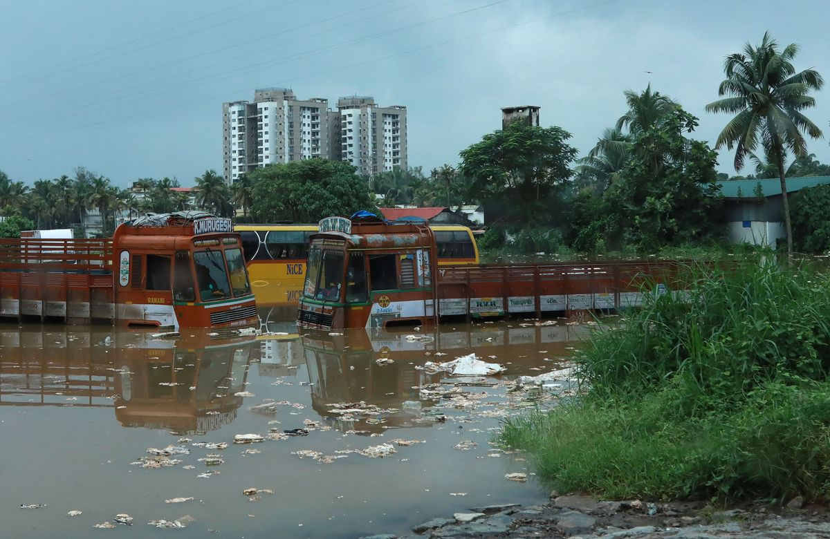 Submerged vehicles on a flooded street are pictured following monsoon rains in Kochi, in the Indian state of Kerala, on August 16, 2018.