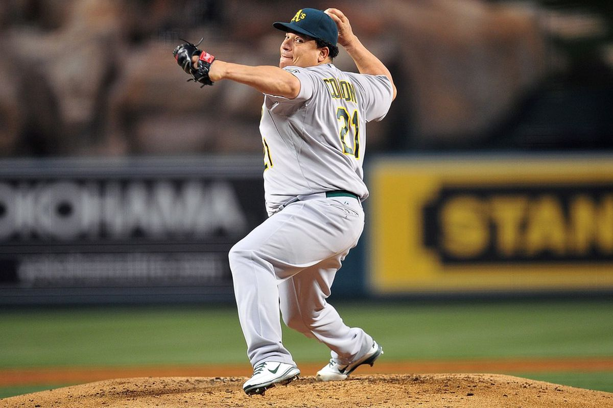 April 18, 2012; Anaheim, CA, USA; Oakland Athletics starting pitcher Bartolo Colon (21) pitches in the second inning against the Los Angeles Angels at Angel Stadium. Mandatory Credit: Gary A. Vasquez-US PRESSWIRE