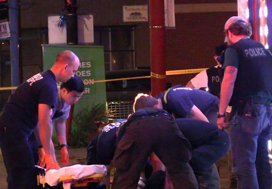 Police and fire officials help a man who was shot about 11:15 p.m. Wednesday, June 20, 2018 in the 8100 block of South Cottage Grove Avenue in Chicago. | Justin Jackson/ Sun-Times