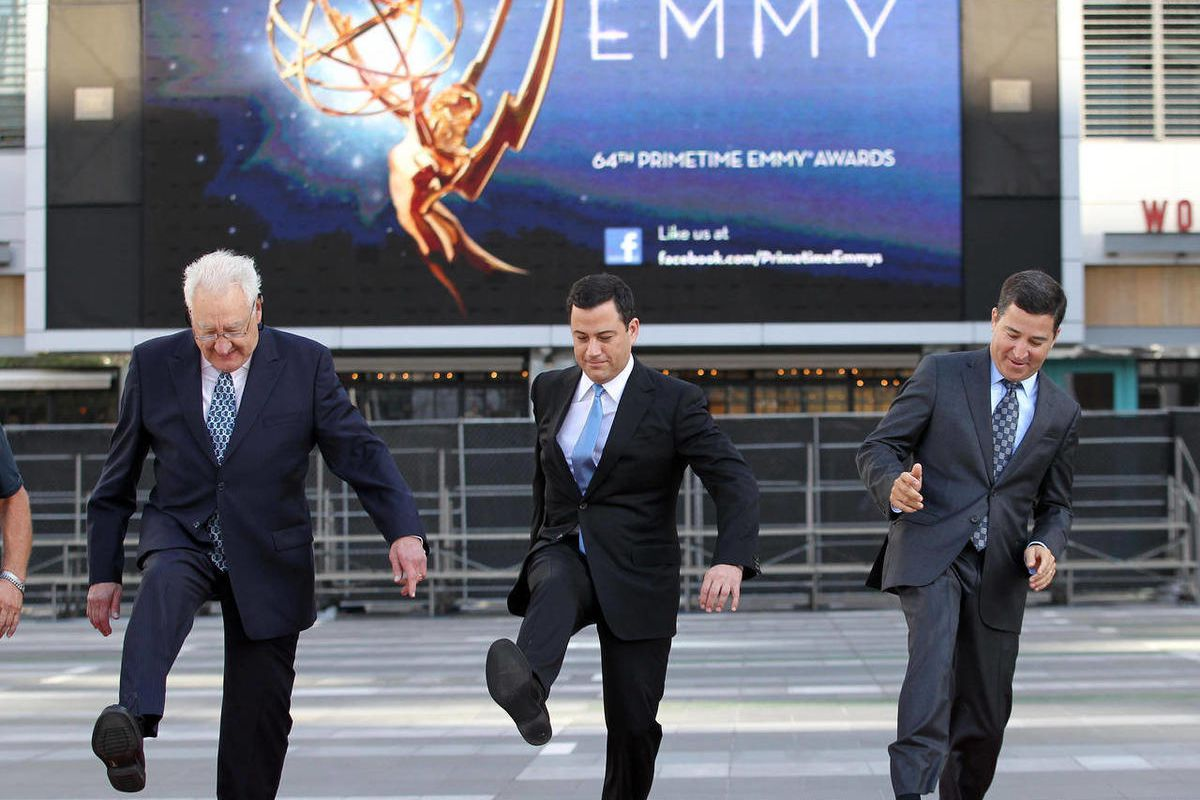 Don Mischer, executive producer of the 64th Primetime Emmy Awards, left, host Jimmy Kimmel, center, and Television Academy chairman and chief executive Bruce Rosenblum attend the Emmy Awards Red Carpet Rollout at the Nokia Theatre on Wednesday, Sept. 19,