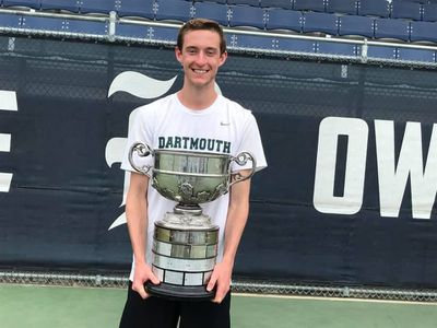 John Speicher holds the trophy that Dartmouth received for winning the Rice Invitational in Houston in 2019.