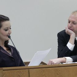 Utah County prosecutor Sam Pead, right, has Gypsy Willis read love letters she exchanged with Martin MacNeill while both were in federal prison for document fraud. She took the witness stand during MacNeill's murder trial in 4th District Court in Provo Thursday Nov. 7, 2013.