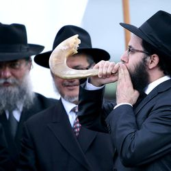 Rabbi Mendy Weitman blows a ram's horn at the traditional Chabad Lubavitch Jewish wedding of Chaya Zippel and Rabbi Mendy Cohen at the Grand America Hotel in Salt Lake City on Monday, Sept. 12, 2016.