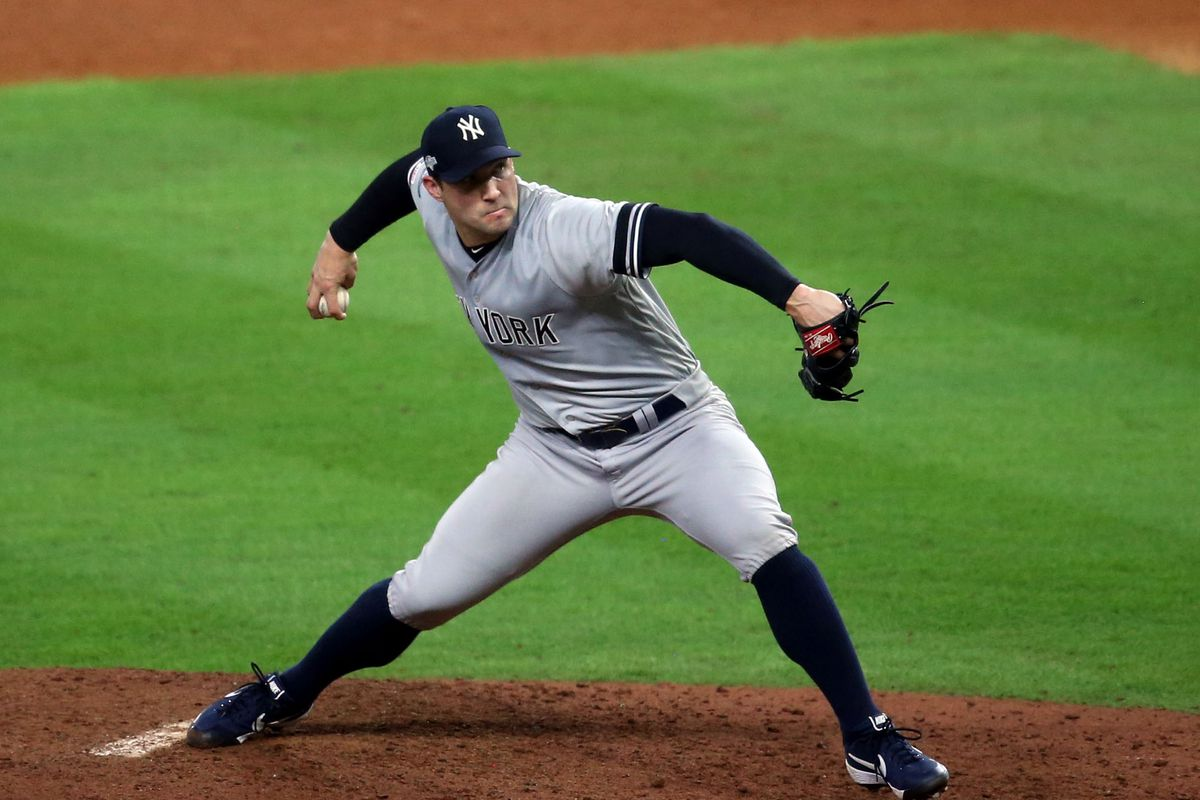 New York Yankees relief pitcher Tommy Kahnle delivers a pitch during the sixth inning against the Houston Astros in game six of the 2019 ALCS playoff baseball series at Minute Maid Park.