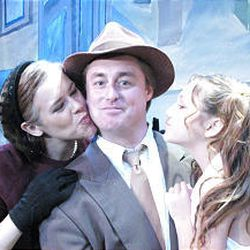 """Shauna Brand as Mary Bailey, Clarence Strohn as George Bailey and Calypso Grey as Zuzu Bailey in Off Broadway's """"It's a Wondrous Life."""""""