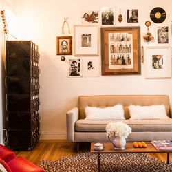 The wall of the lounge area is decorated with photography by their landlord, who was a fashion photographer in the '70s.