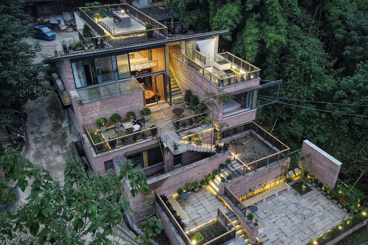 Aerial shot of house with terraces.