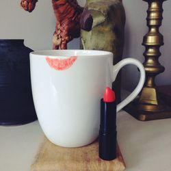 """Before heading out for brunch, I put on a really pretty coral lip color, <a href=""""Young Blood cosmetics: http://www.ybskin.com/lipstick-1621.html#color=793_837"""">Tangelo</a>, from <b>Young Blood</b>."""