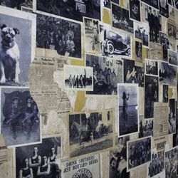 Old newspaper clips and black and white photos decorate one wall.