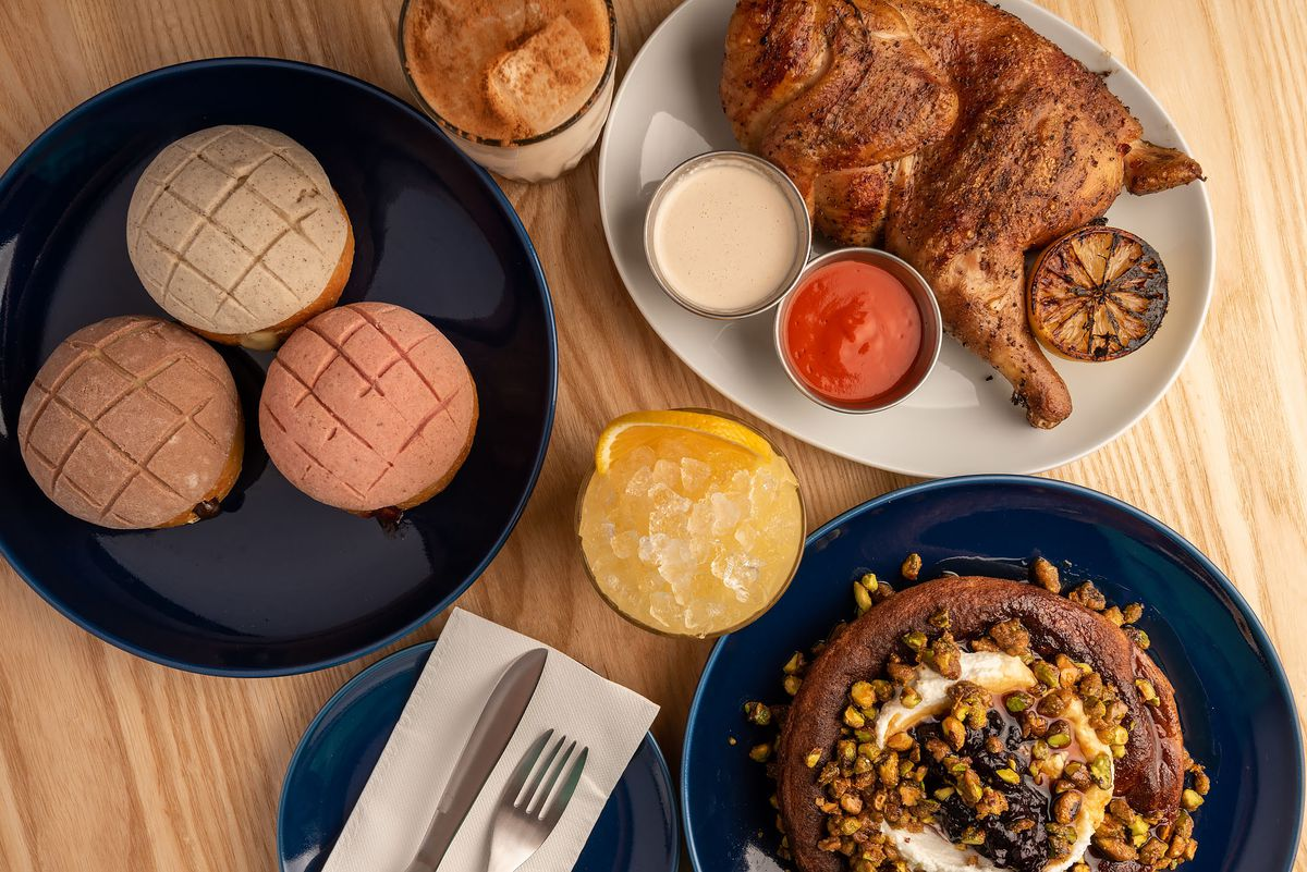 An overhead view of conchas, chicken, and pancakes.