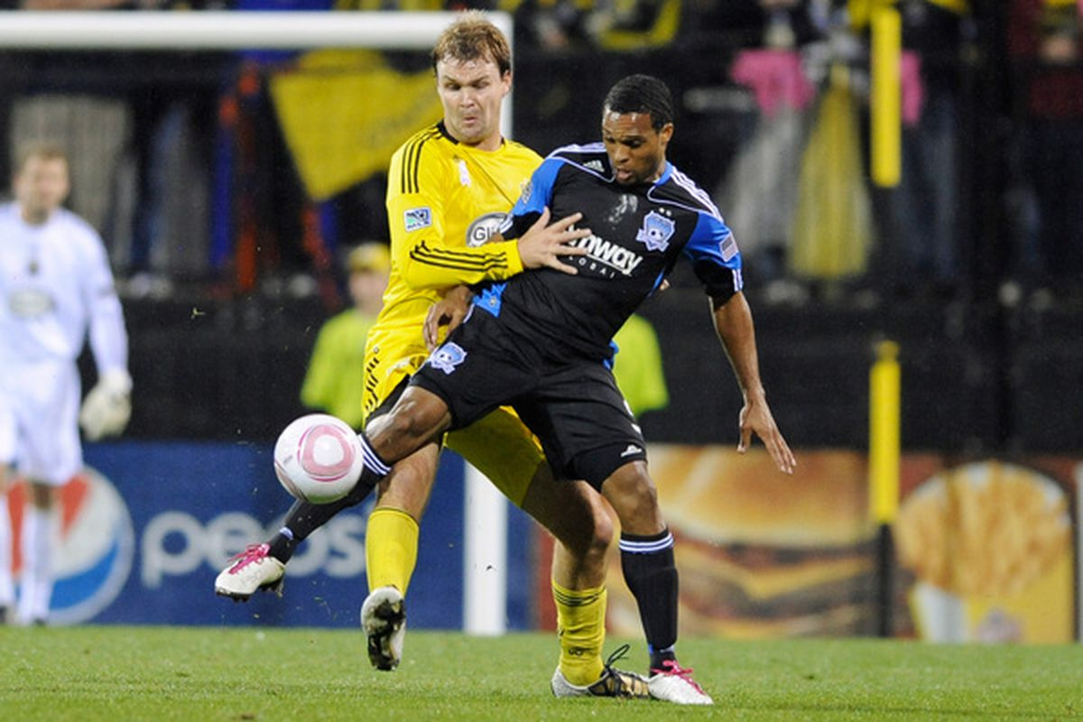 COLUMBUS OH - OCTOBER 2:  Scott Sealy #9 of the San Jose Earthquakes keeps control of the ball in front of Chad Marshall #14 of the Columbus Crew on October 2 2010 at Crew Stadium in Columbus Ohio.  (Photo by Jamie Sabau/Getty Images)