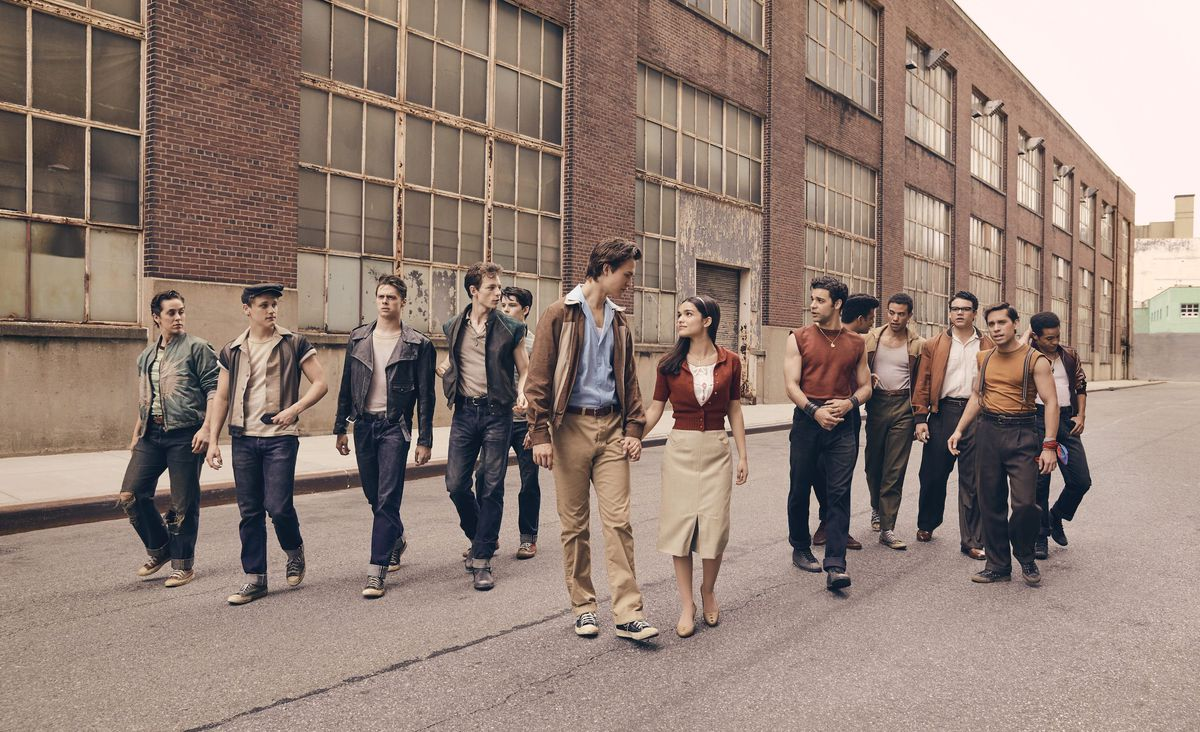 two groups of young men surround a young man and woman holding hands in West Side Story (2020)
