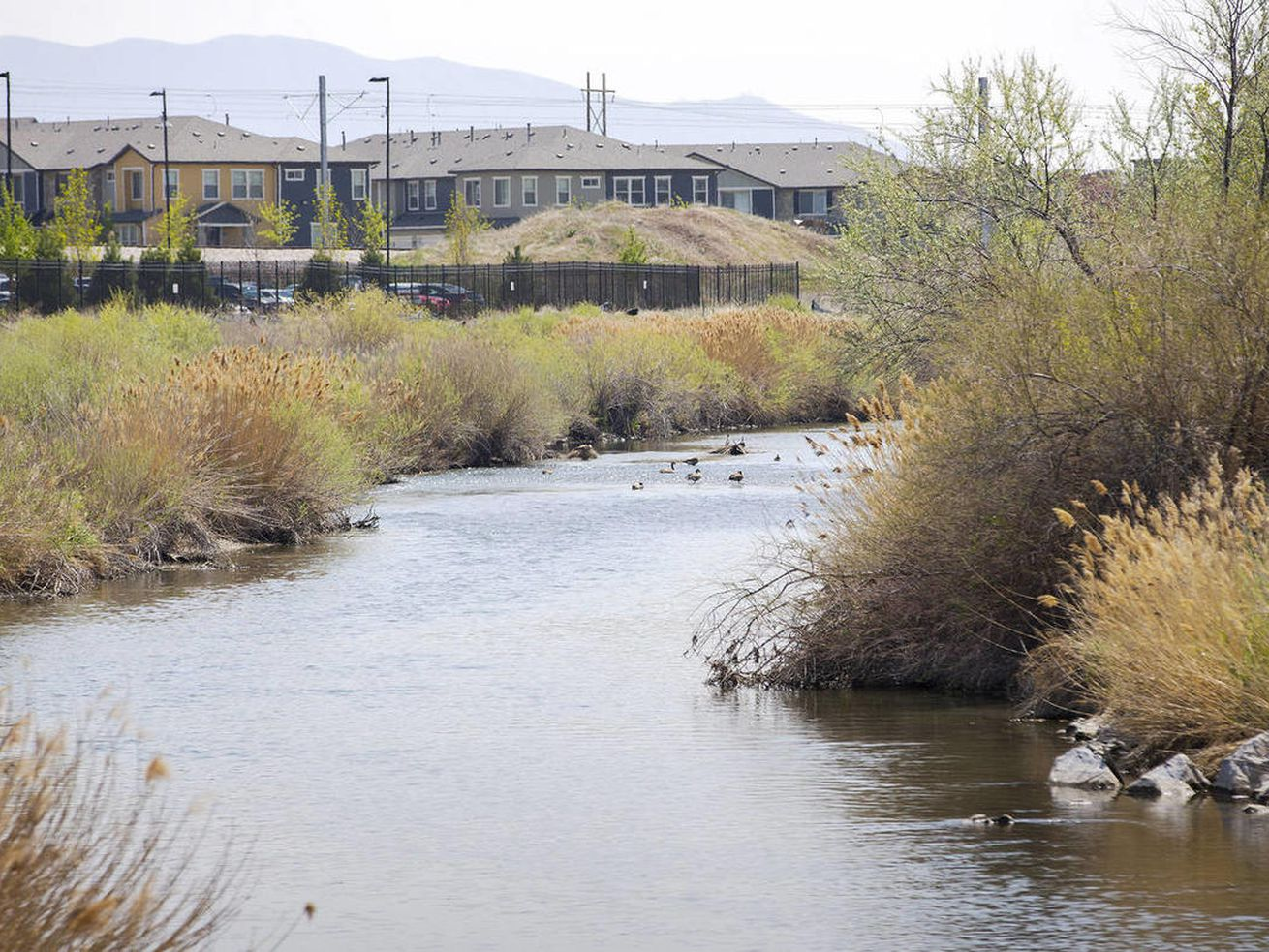 The Jordan river flows past the old smelter area of the Midvale slag superfund site as it was officially removed from the U.S. Superfund list at a ceremony Monday, April 20, 2015, at FLSmidth in Midvale.